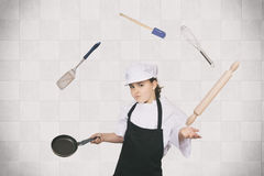 Cook girl juggling Royalty Free Stock Image