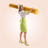 Cook girl with large delicious spaghetti Royalty Free Stock Image