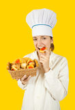 Cook girl in toque with pastry Stock Images