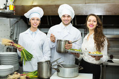 Cook gives to waitress plates Royalty Free Stock Photography