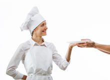 Cook giving empty plate to man's hands Stock Images