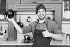 Cook in good mood. Relax put on some music. Composed cook is more efficient one. Man chef likes to cook in relaxing. Atmosphere. Guy professional chef feels stock photo