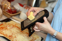 Cook grating cheese Stock Photos