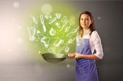 Cook with green doodle vegetables. Cooking with green doodle vegetables and kitchen staff stock images
