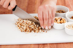 Cook grinds chickpeas with knife Royalty Free Stock Image