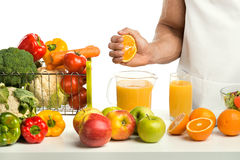 Cook by hand freshly squeezed orange juice Stock Photos