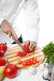 Cook hand with knife cutting vegetable Stock Photo