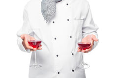 Cook hands holding of wine glasses on the front of the chest Royalty Free Stock Photo