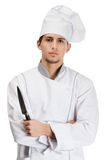 Cook hands knife. Cook in uniform hands knife, isolated on white Royalty Free Stock Image