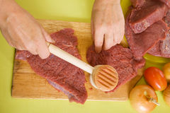 Cook hands making tenderized steak Stock Images