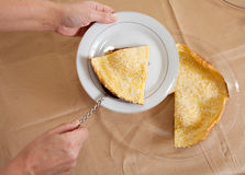 Cook hands with  omelet Royalty Free Stock Photos