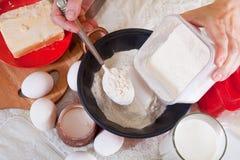 Cook hands pours  flour Stock Images