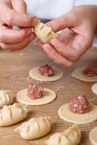 Cook hands preparing Asian gyoza  dumplings Stock Images