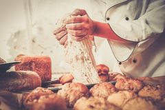 Cook hands preparing dough Royalty Free Stock Photography