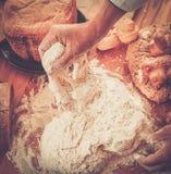 Cook hands preparing dough stock image