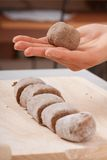Cook hands preparing dough Royalty Free Stock Photos