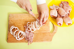 Cook hands is slicing of boiled squid Royalty Free Stock Photography