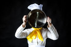 Cook hiolding pan. Royalty Free Stock Photos