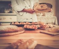 Cook holding baked goods Stock Image