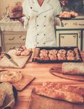 Cook holding baked goods Royalty Free Stock Images