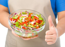 Cook is holding a big bowl with fresh salad Royalty Free Stock Photography