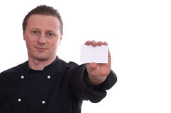 Cook is holding a business card Stock Images