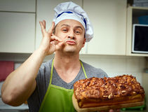 Cook holding cake with walnuts Royalty Free Stock Images