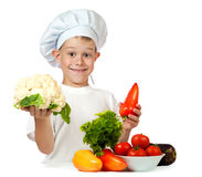 Cook is holding cauliflower and bell pepper Stock Image