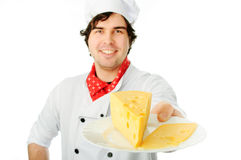 Cook holding cheese stack. Royalty Free Stock Photo