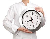 Cook holding a clock Stock Image