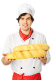 Cook holding couple breads Royalty Free Stock Photo