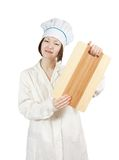 Cook holding cutting board Royalty Free Stock Photos