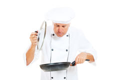 Cook holding frying pan and cover Royalty Free Stock Photos