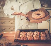 Cook holding homemade baked goods Stock Photography