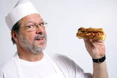 Cook holding hot dog royalty free stock images