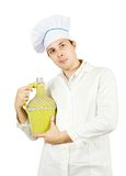 Cook holding large bottle Stock Images