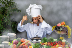 Cook holding pan over gray background restaurant Royalty Free Stock Photo