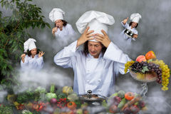 Cook holding pan over gray background restaurant Royalty Free Stock Photos