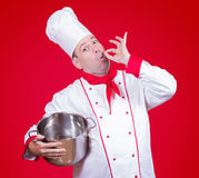 Cook holding a pot with gesture okay Stock Images
