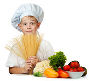 Cook is holding raw spaghetti.  Stock Photo