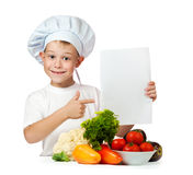 Cook is holding with a sheet of paper.  Stock Images