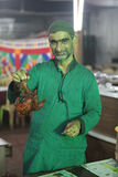 A cook holds a delicious tandoori chicken during the ramadan fea Royalty Free Stock Photo