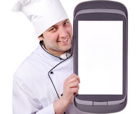 Cook holds a giant phone. Communicator, computer Royalty Free Stock Images