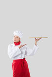 Cook holds in one hand a tray Royalty Free Stock Images
