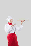 Cook holds in one hand a tray Royalty Free Stock Photography