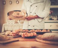 Cook with  homemade baked goods Royalty Free Stock Image