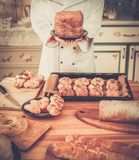 Cook with  homemade baked goods Royalty Free Stock Photos