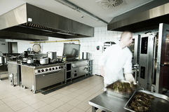 Cook in industrial kitchen Stock Photography