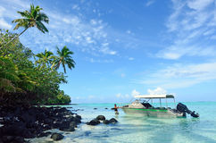 Cook Islander man with his fishing boat. In Atoll at the Aitutaki lagoon Cook Islands Royalty Free Stock Image