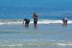 Cook Islander men checks fishing net in Raroronga Cook Islands stock photos